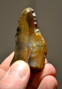 A superb and very attractive large Neanderthal [Mousterian] flint pointed side scraper from Reculver, Kent. SOLD